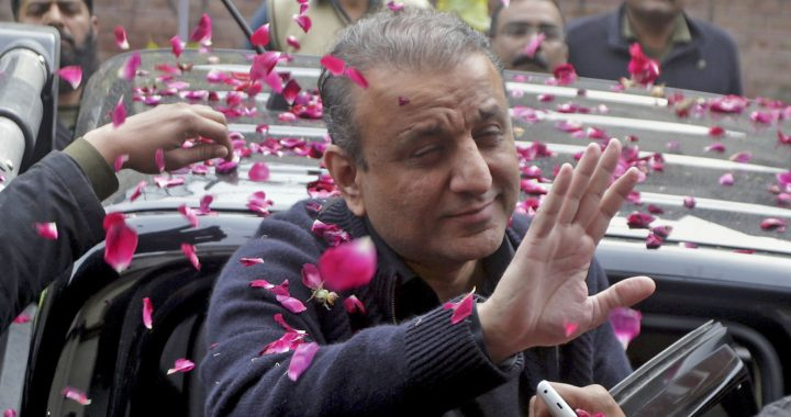 People shower rose petals on former Punjab Provincial Minister for Local Bodies, Abdul Aleem Khan arrives at the anti-graft tribunal in Lahore, Pakistan, Thursday, Feb. 7, 2019. A Pakistani court has ordered that Khan, a senior politician from Prime Minister Imran Khan's ruling party, be held in custody for nine days so that an anti-graft body can question him on corruption allegations. (AP Photo/K.M. Chaudary)