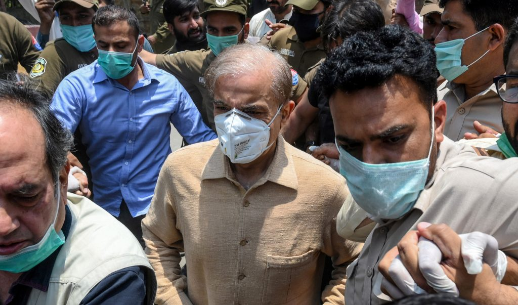 Pakistan's opposition leader Shahbaz Sharif (C) arrives at the High Court in Lahore on June 3, 2020. - Shahbaz Sharif was granted interim bail on June 3 by the Lahore High Court till June 17, restraining the National Accountability Bureau (NAB) from arresting the leader of the opposition in money-laundering and assets beyond means investigation, according to local reports. (Photo by Arif ALI / AFP)